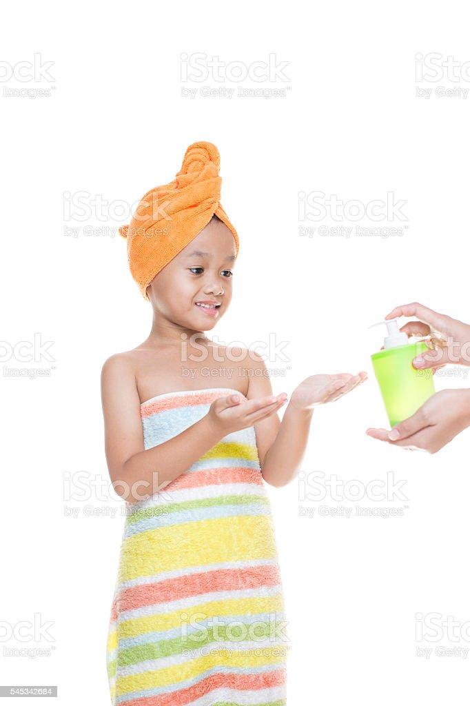 cute little girl getting ready to take a bath stock photo