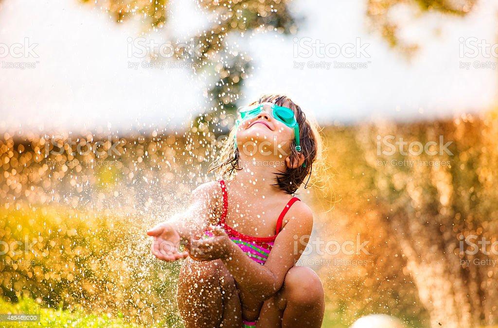 Cute little girl having fun outside stock photo