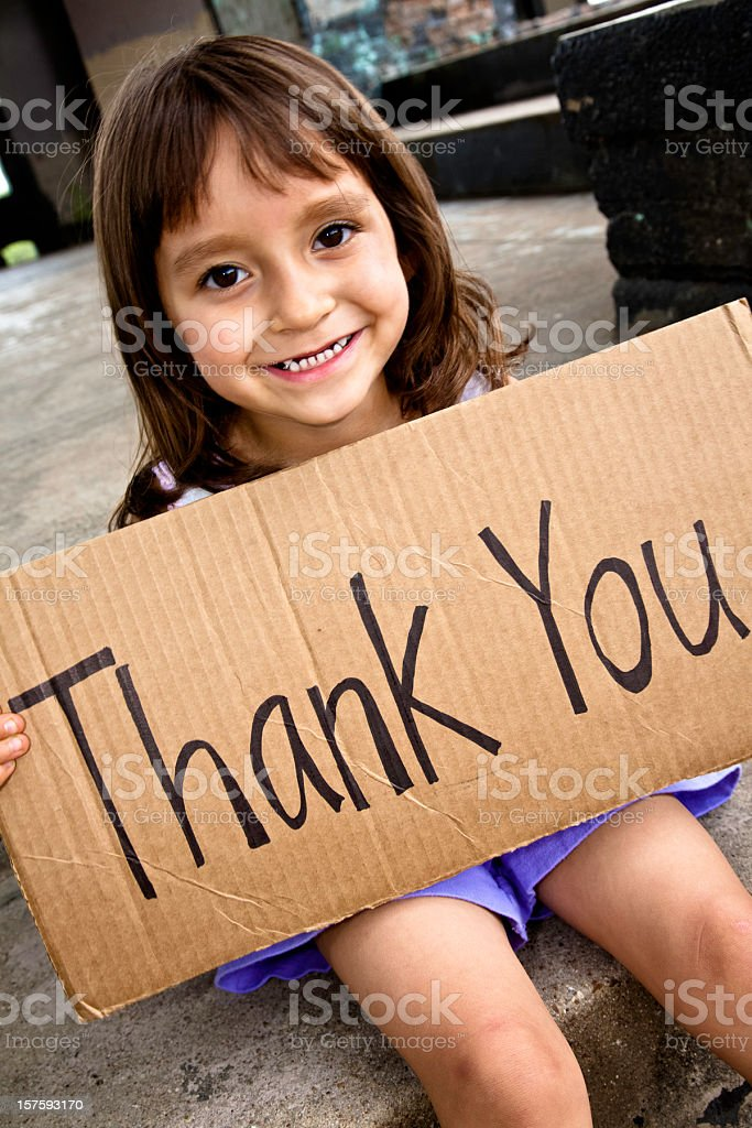 Cute Little Girl Holding a Thank You Sign royalty-free stock photo