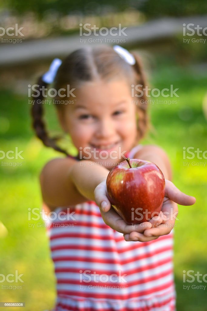 Cute little girl holding apple stock photo