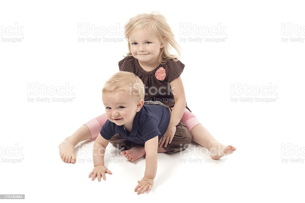 Cute Little Girl Holding Baby Brother royalty-free stock photo