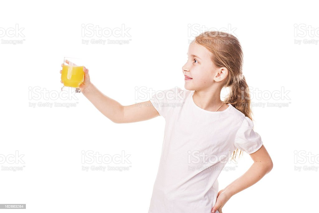 Cute little girl holding glass with juice smiling royalty-free stock photo
