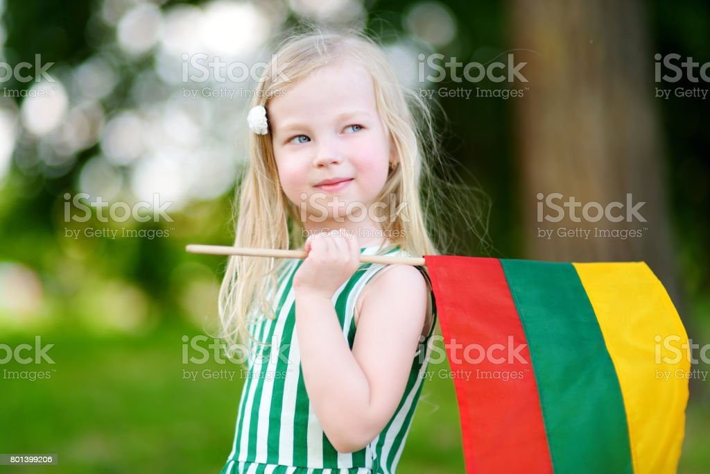 Cute little girl holding tricolor Lithuanian flag stock photo