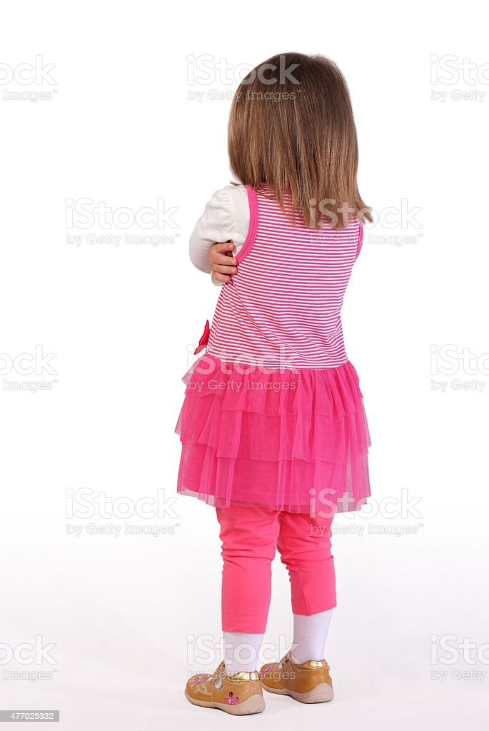Cute little girl in a pink dress stock photo