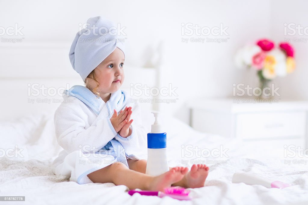Cute little girl in a towel after bath stock photo