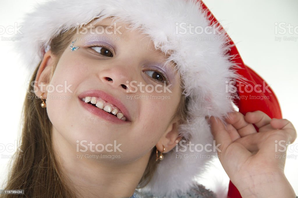 Cute little girl in claus hat stock photo