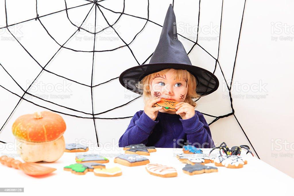 cute little girl in halloween costume stock photo