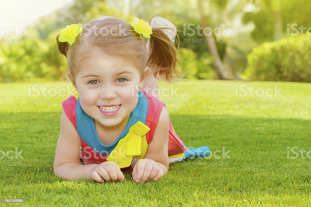 Cute little girl in park royalty-free stock photo