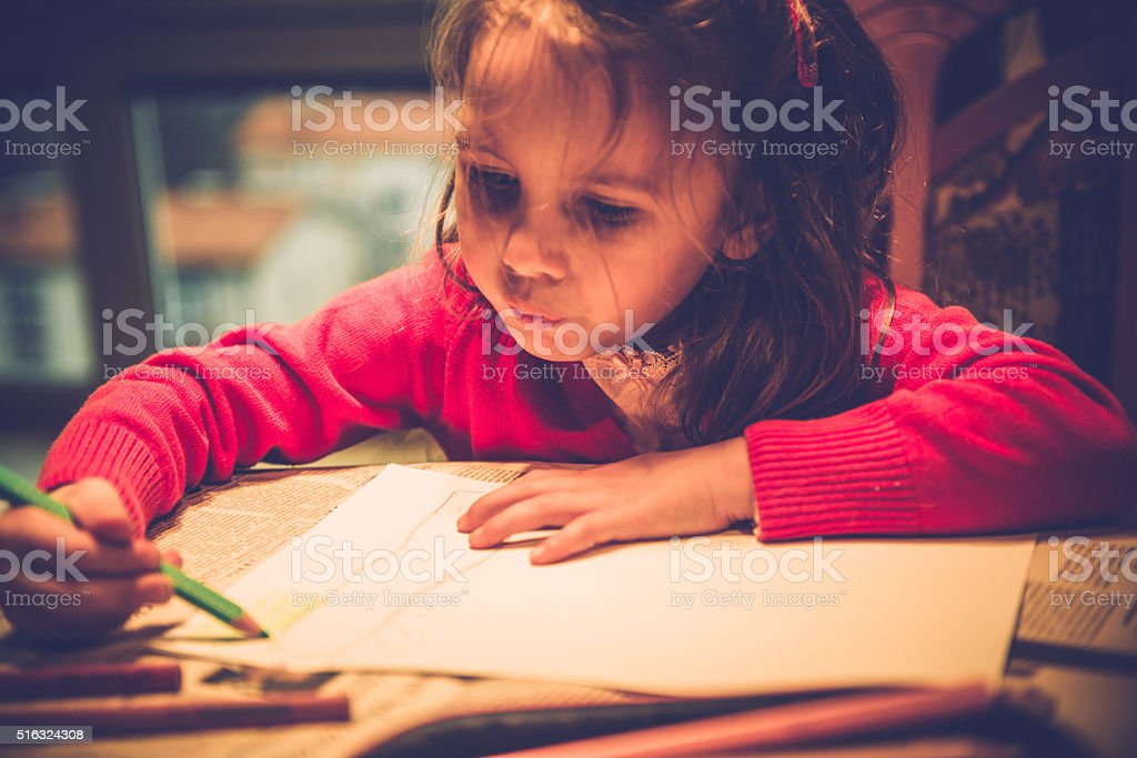 Cute Little Girl in Pink Drawing in at Home, Europe stock photo