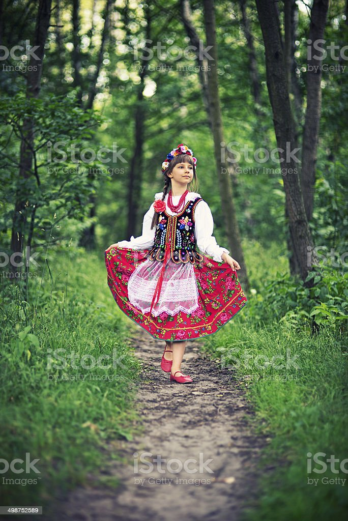 Cute little girl in polish folk costume (Cracow region) stock photo