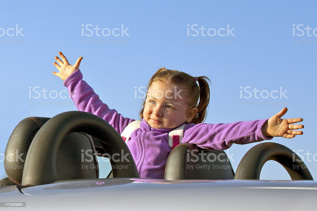 Cute Little girl in sport car royalty-free stock photo