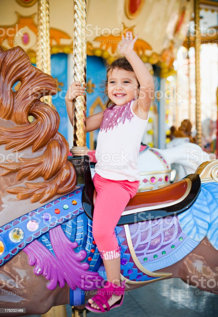 Cute Little Girl in The Merry Go Round stock photo