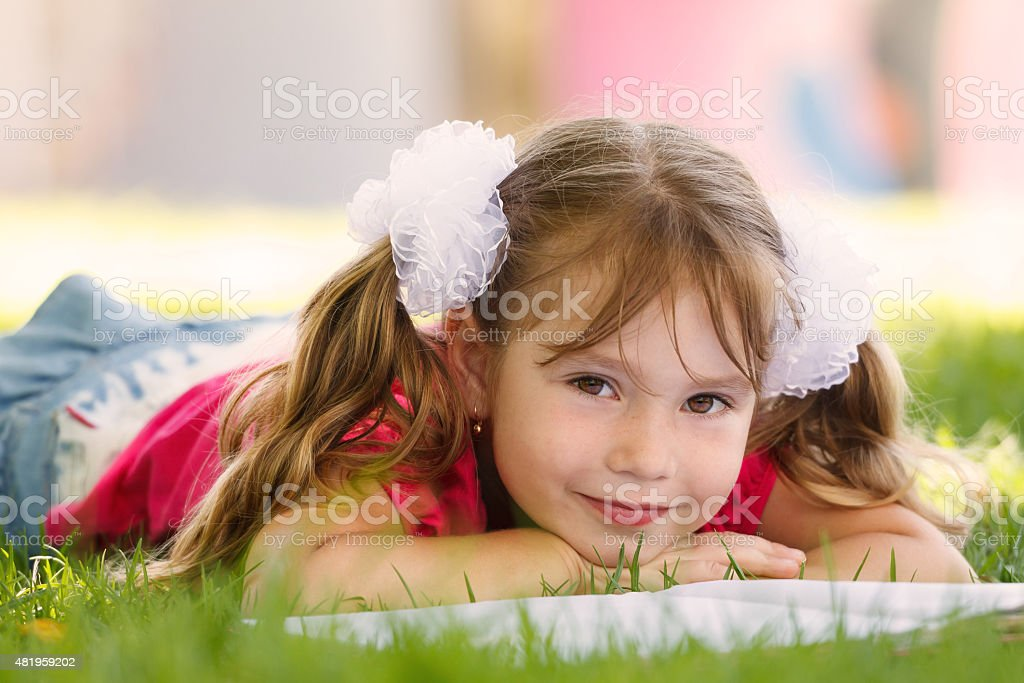 Cute little girl is reading a book stock photo