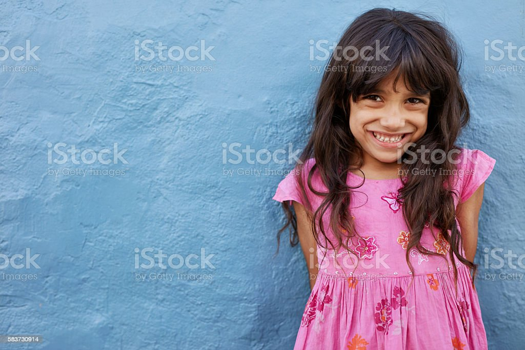Cute little girl looking at camera and smiling stock photo
