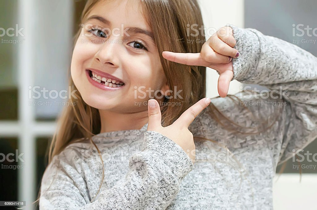 Cute little girl looking stock photo