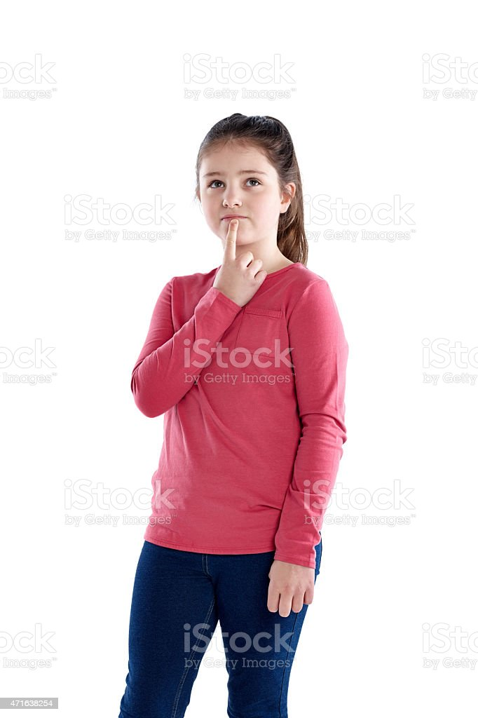 Cute little girl looking up thinking stock photo