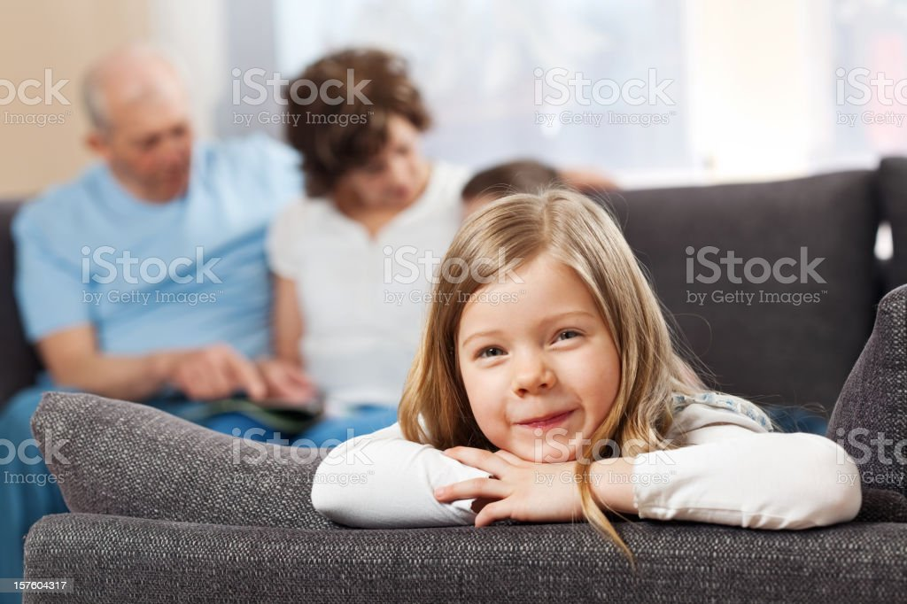 Cute little girl lying on sofa and smiling royalty-free stock photo