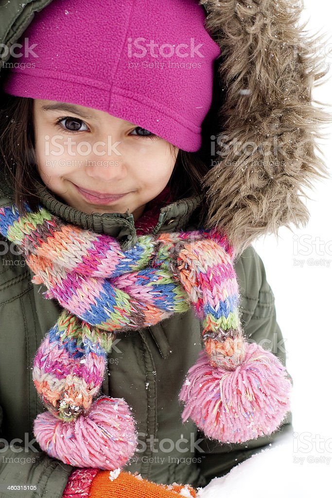 Cute little girl making a snowman stock photo