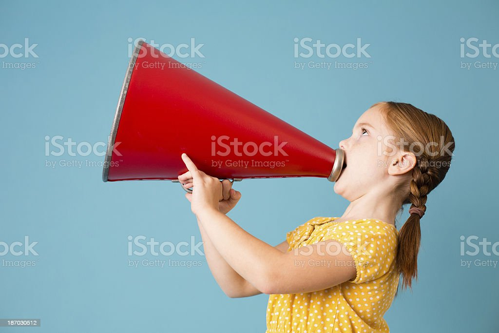 Cute Little Girl Making Announcement With Megaphone royalty-free stock photo