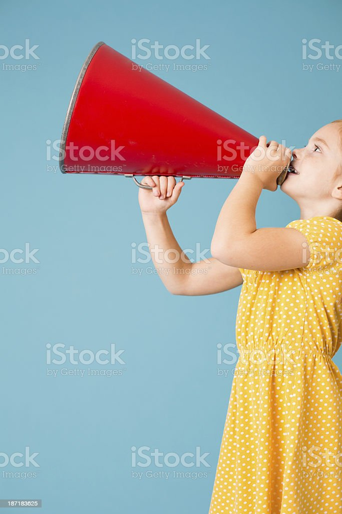 Cute Little Girl Making Announcement With Megaphone stock photo