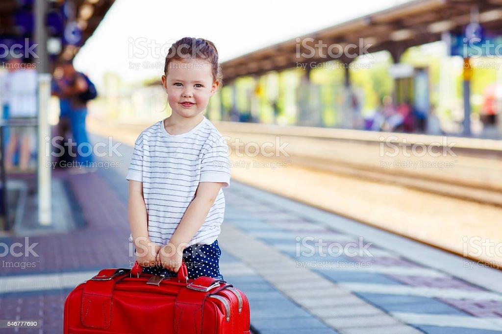 Cute little girl on a railway station. stock photo