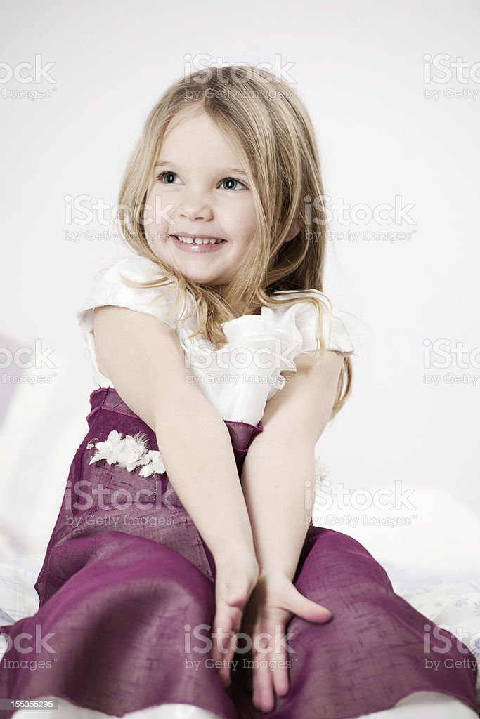 Cute little girl on bed royalty-free stock photo