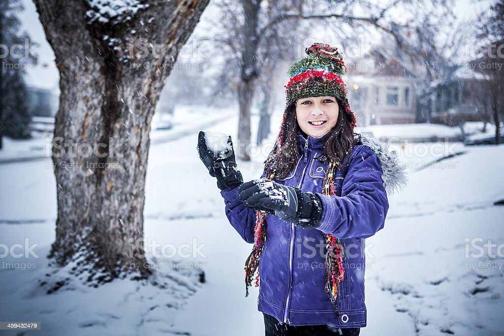 Cute Little Girl Outside in Winter Throwing a Snowball royalty-free stock photo