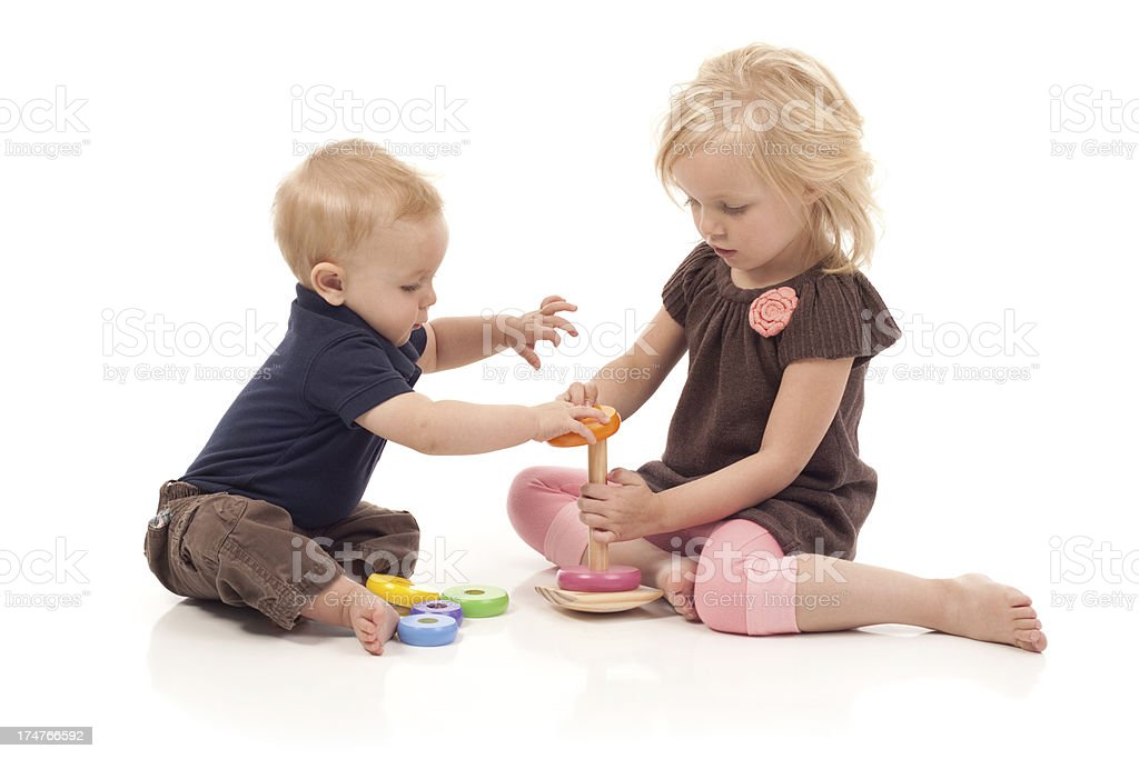 Cute Little Girl Playing Baby Brother royalty-free stock photo