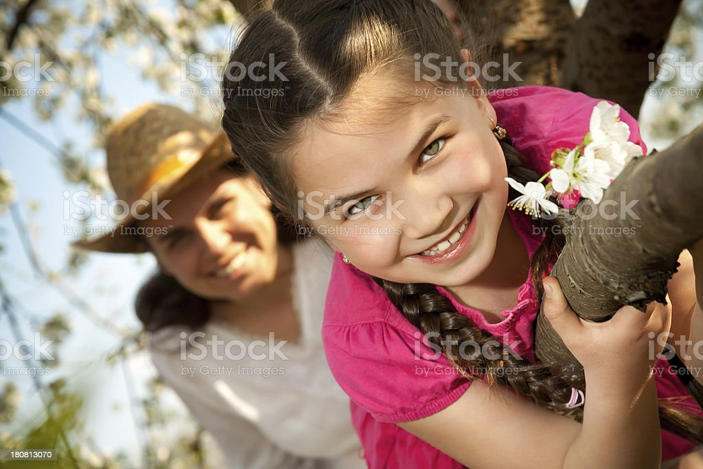 Cute little girl playing, enjoying on the tree royalty-free stock photo