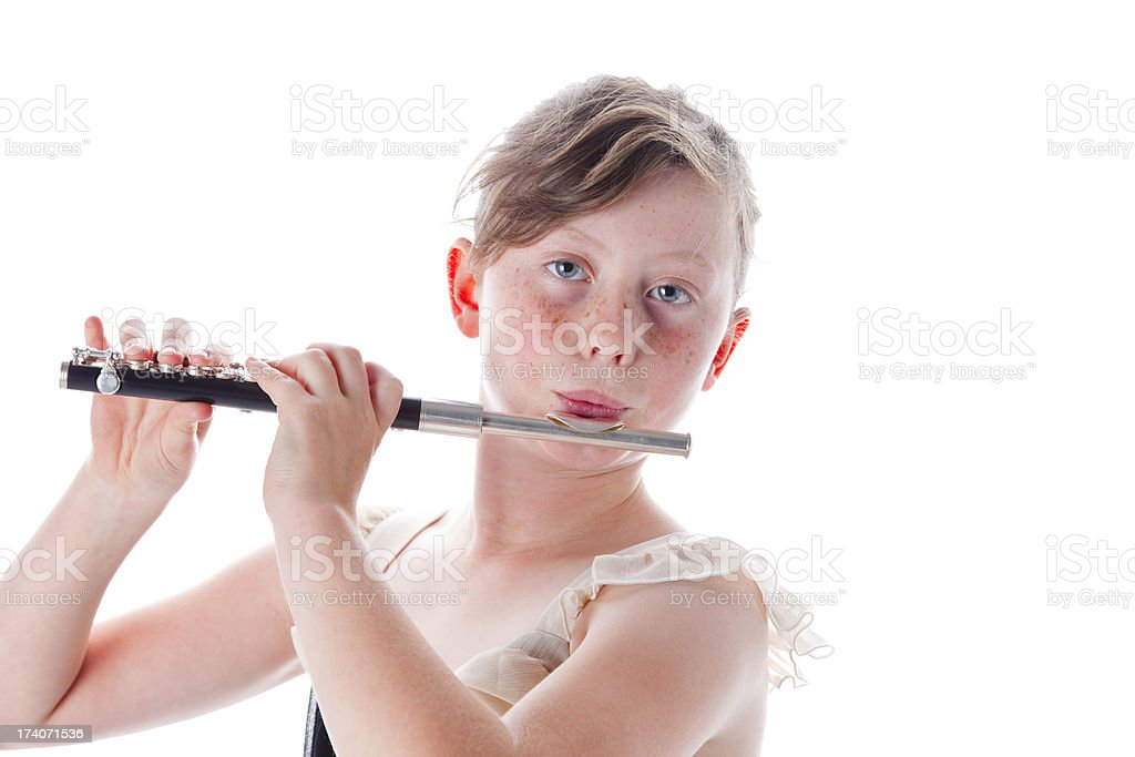 Cute Little Girl Playing Her Piccolo stock photo