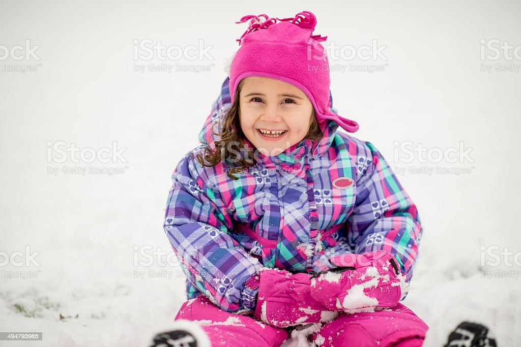 Cute Little Girl Playing in the Snow stock photo