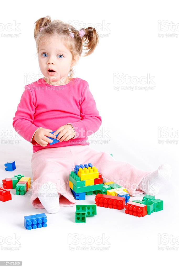 Cute little girl playing with blocks royalty-free stock photo