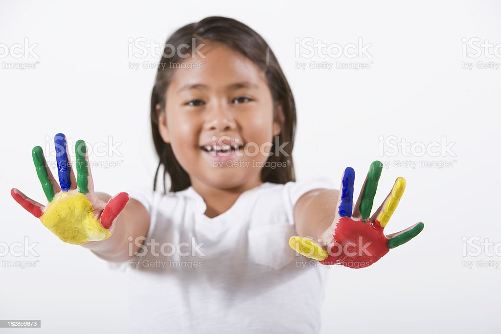 Cute little girl playing with finger paints, hands in focus royalty-free stock photo