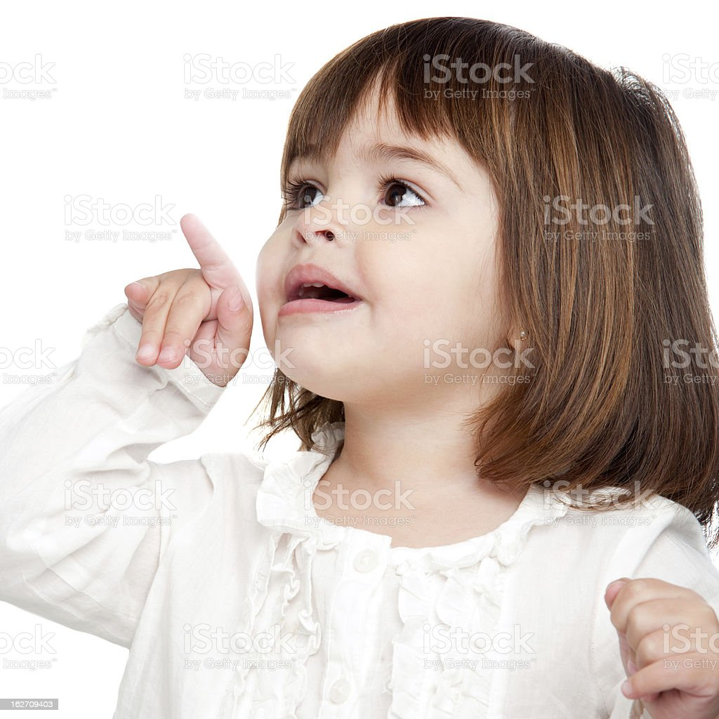 Cute little girl pointing with finger royalty-free stock photo