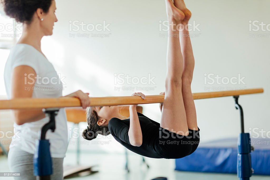 Cute Little Girl Practicing Gymnastics. stock photo