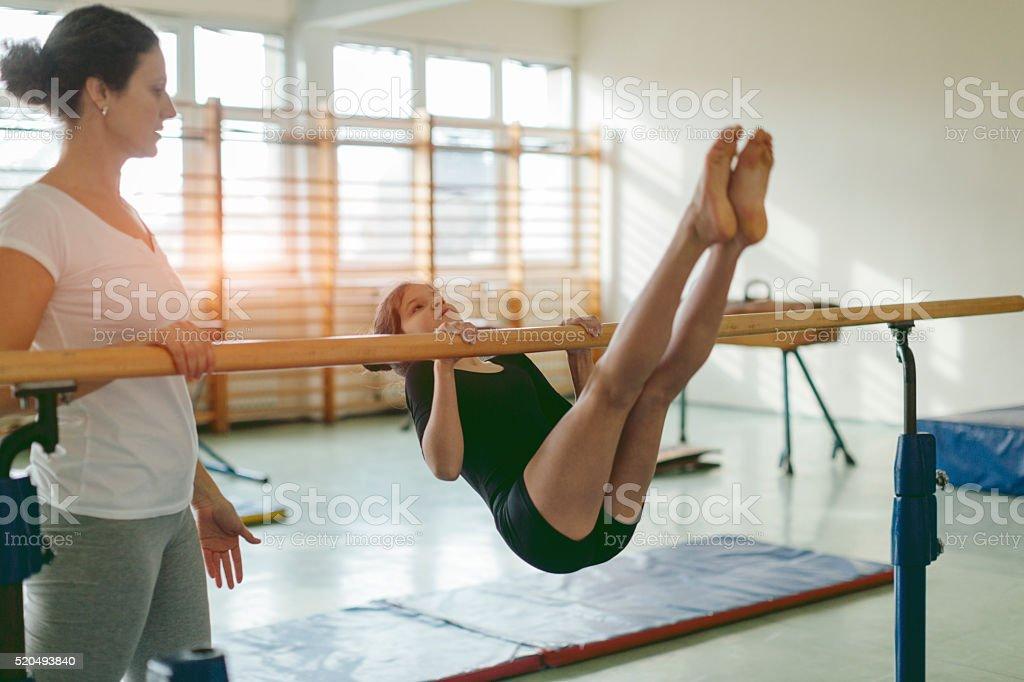 Cute Little Girl Practicing Gymnastics. stock photo