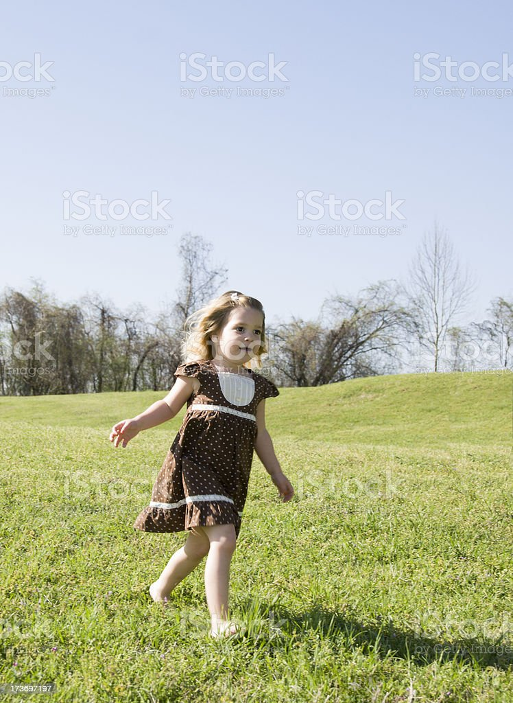 Cute Little Girl running Outdoors royalty-free stock photo