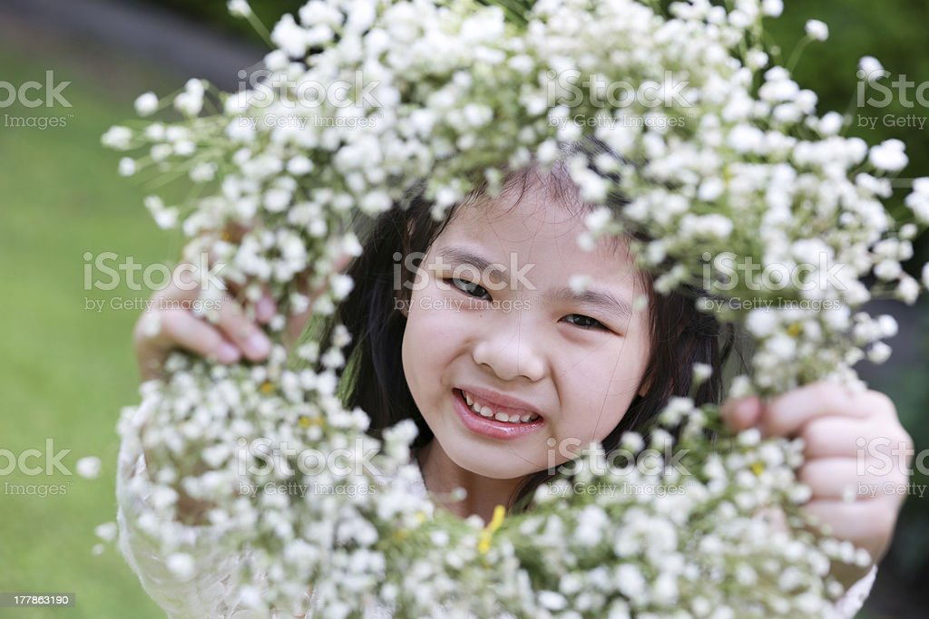 Cute little girl showing a flower tiara royalty-free stock photo