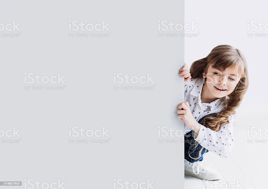Cute little girl showing gray banner stock photo