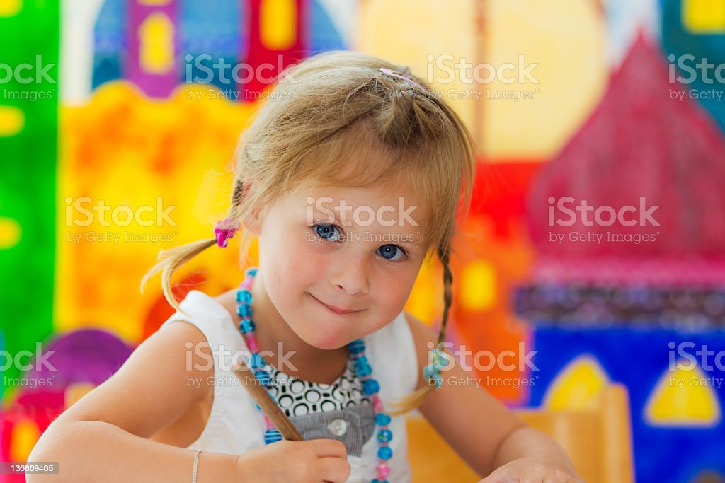 Cute little Girl smiles and looks into the camera stock photo