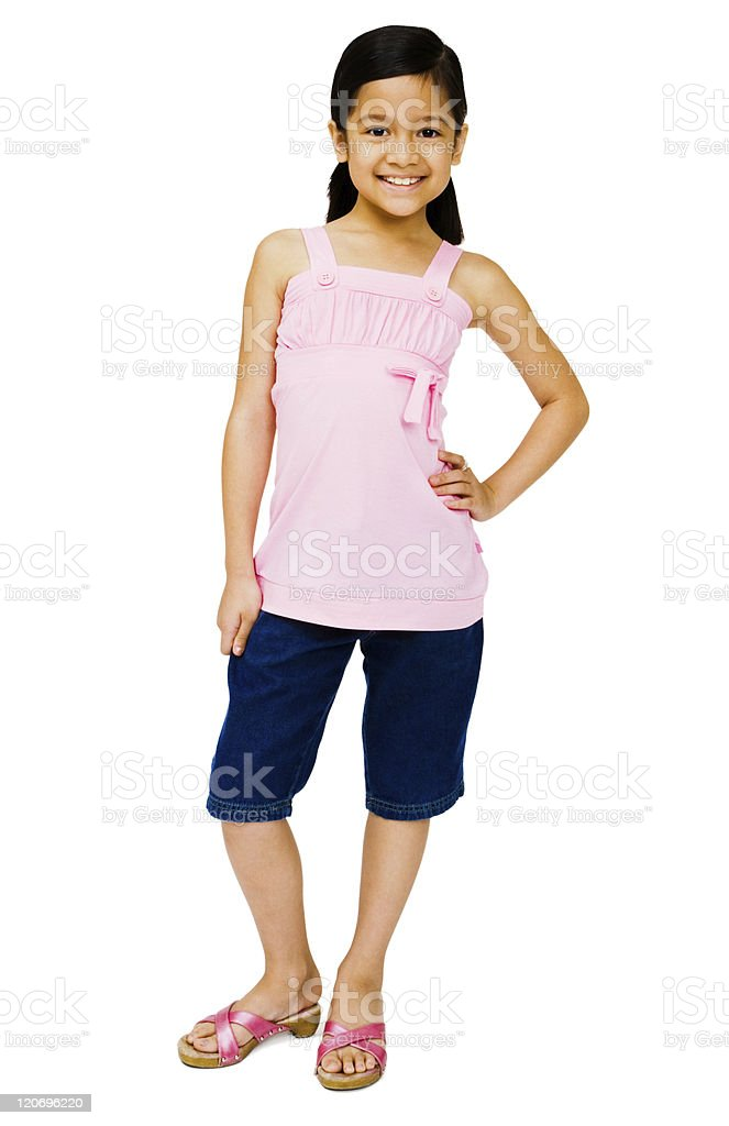 A cute little girl smiling and posing for the camera stock photo
