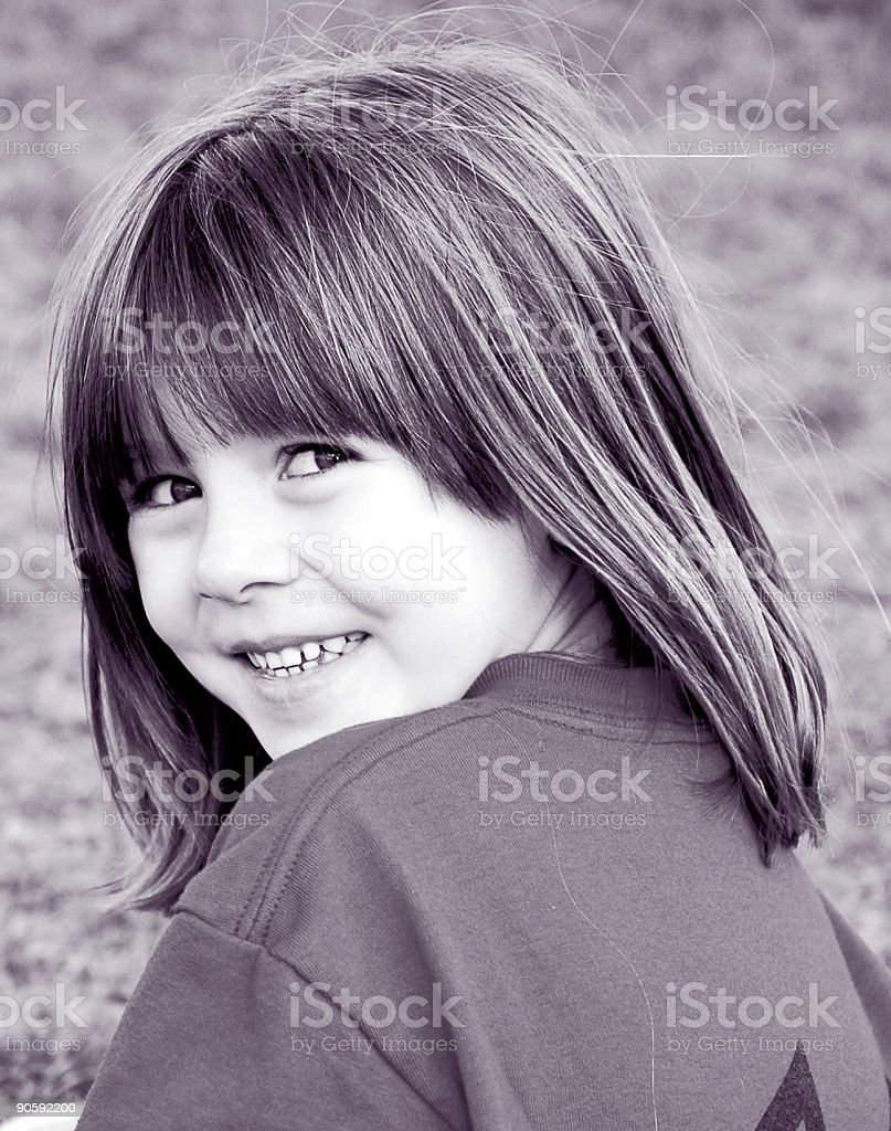 Cute Little Girl Smiling - Black and White stock photo