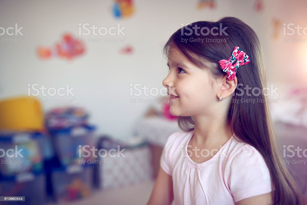 cute little girl smiling stock photo