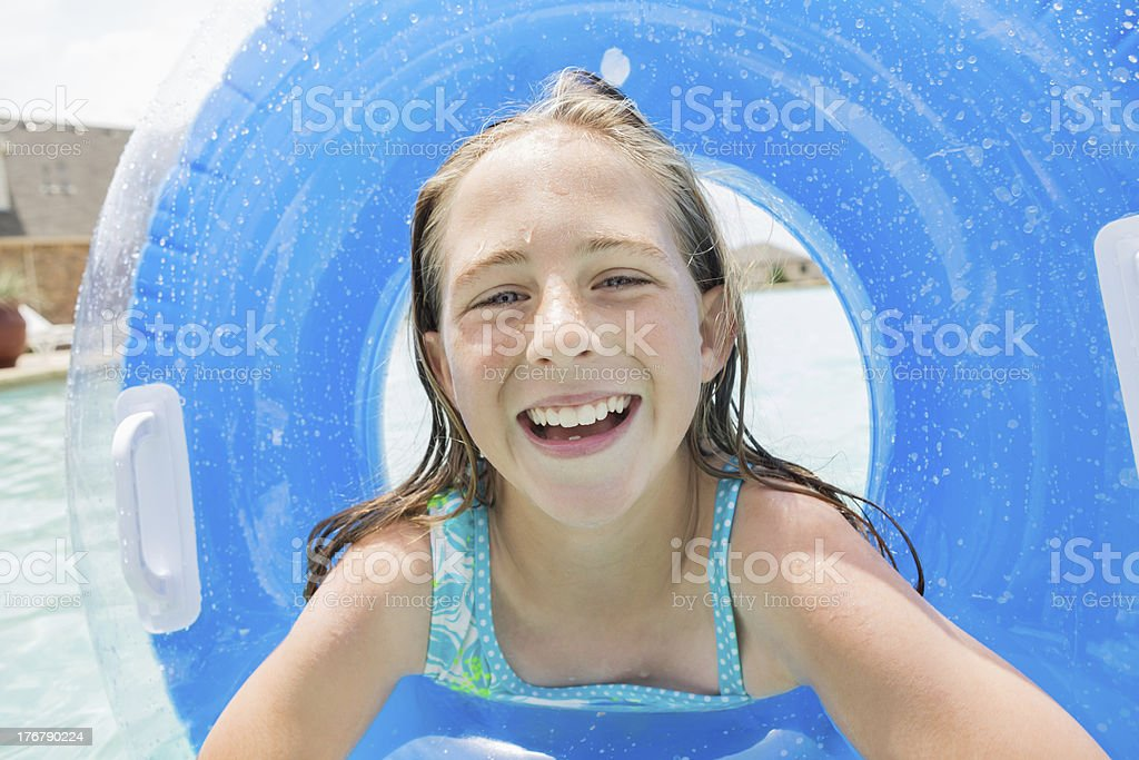 Cute little girl swimming with pool toy royalty-free stock photo