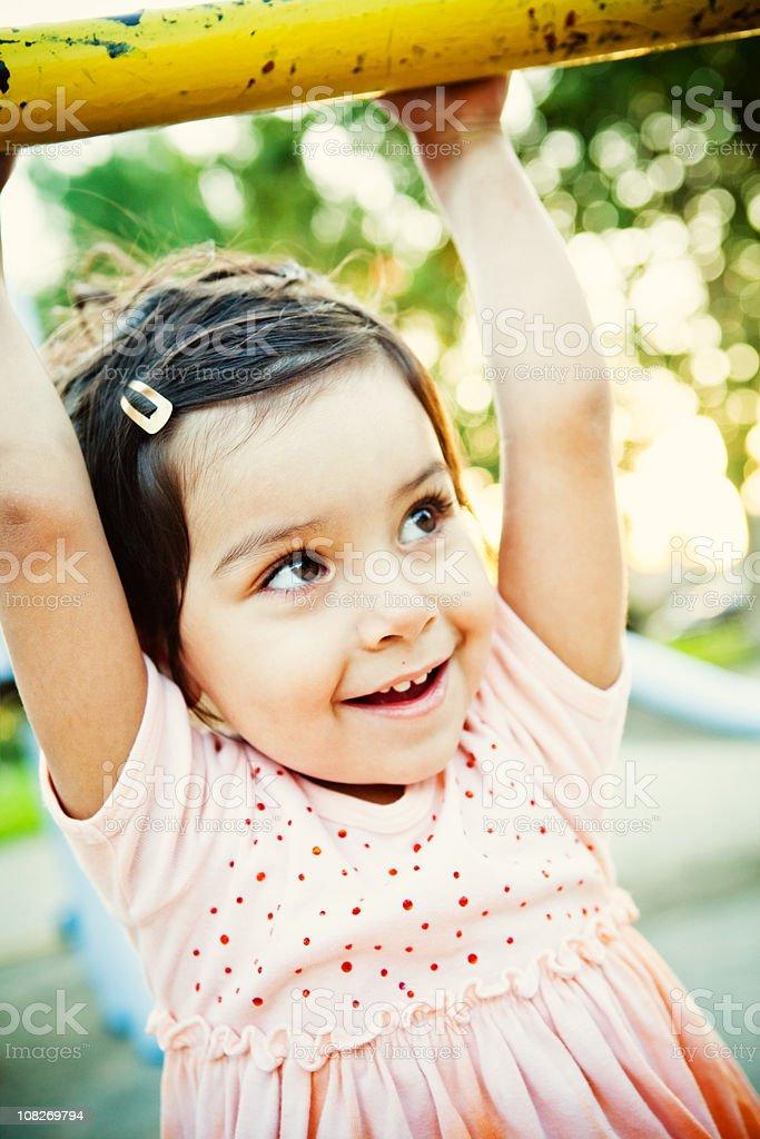 cute little girl swinging on bar royalty-free stock photo