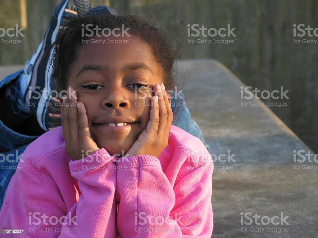 little girl thinks royalty-free stock photo