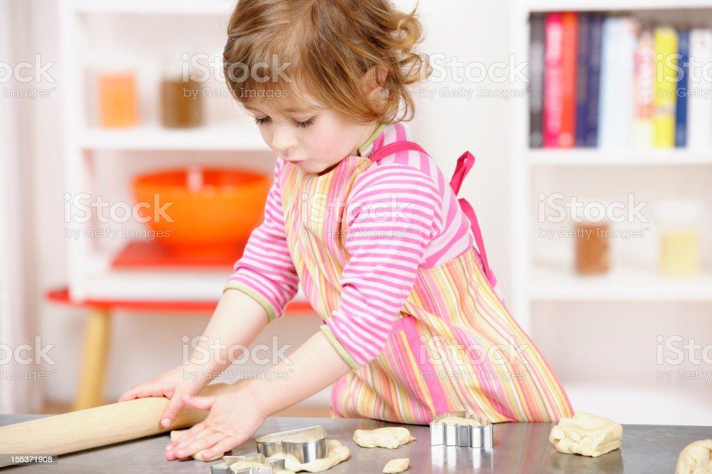 Cute Little Girl/ Toddler Preparing Dough stock photo