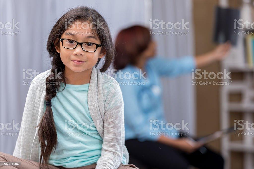 Cute little girl waits in emergency room stock photo