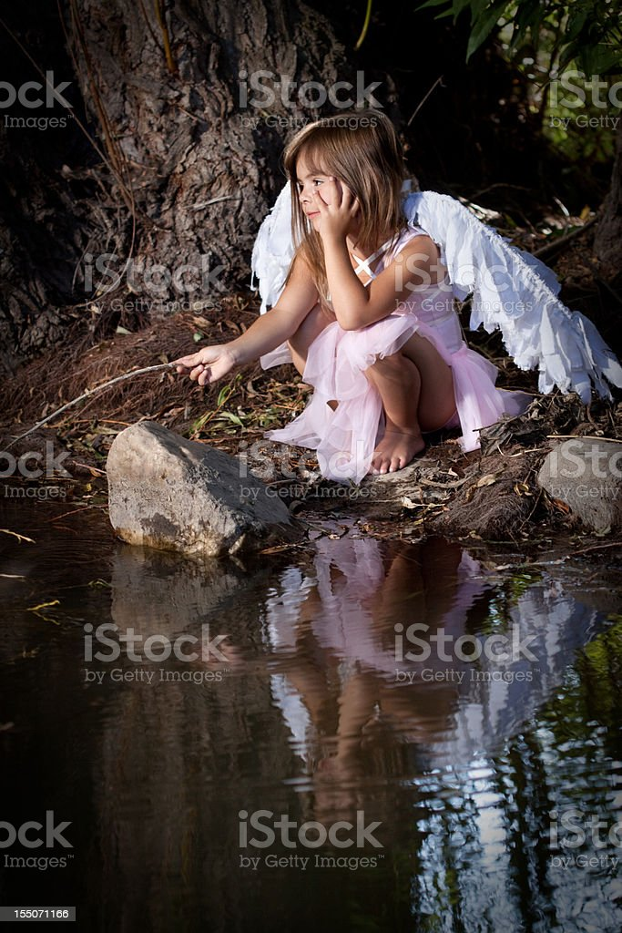 Cute Little Girl Wearing Fairy Costume Outdoors in Forest royalty-free stock photo
