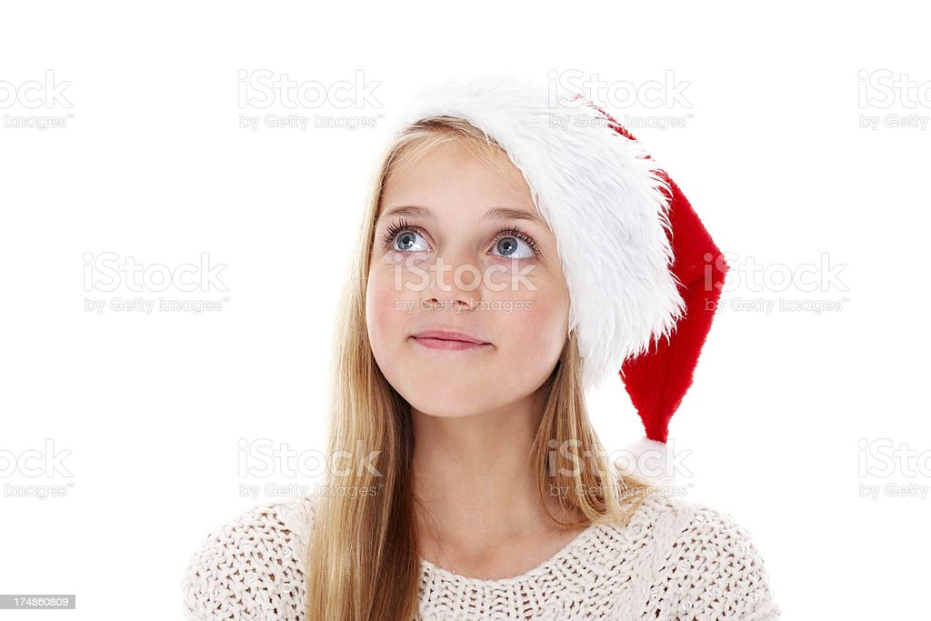 Cute little girl wearing Santa hat looking away at copyspace royalty-free stock photo